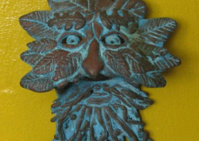 Bronze Green Man Face